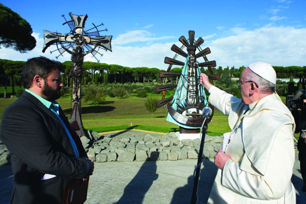 Pope Francis blesses two new statues by Argentine artist Alejandro Marmo, left, at the papal villa at Castel Gandolfo, Italy, Nov. 16. The statues are iron sculptures of the crucified Christ and Our Lady of Lujan. (CNS photo/L'Osservatore Romano) See POPE-CASTELGANDOLFO Nov. 17, 2014.