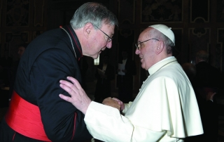 Cardinal George Pell of Sydney greets Pope Francis