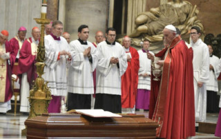 Pope Francis incenses the coffin of the late Cardinal Elio Sgreccia in St. Peter's Basilica on Friday, June 7.